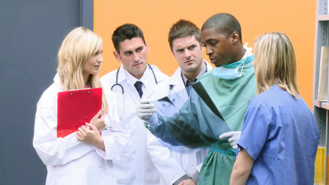 Footage of medical team studying an xray in hospit Footage