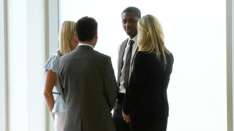 Business people speaking in workplace footage Stock Video Footage