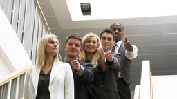 Business people in a line on stairs with thumbs up Stock Video Footage