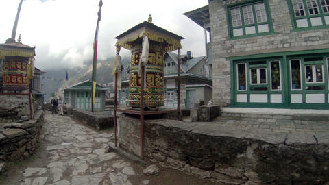 Tourists spins a giant prayer wheel. Full HD Stock Video Footage