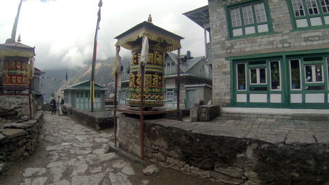 Tourists spins a giant prayer wheel. Full HD Footage