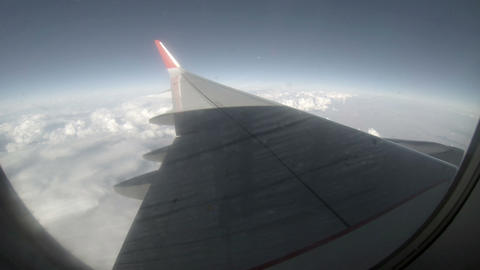 Airplane Wing Out Of Window On Blue Sky Background stock footage