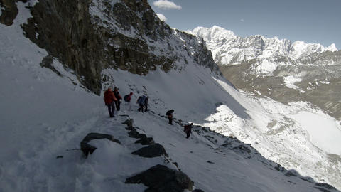Group of tourists coming down from the Renjo Pass. Footage