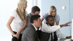 Young ethnic manager explaining to his team a project in... Stock Video Footage