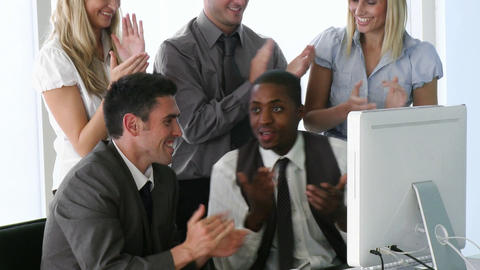 AfroAmerican manager explaining to his team a proj Footage