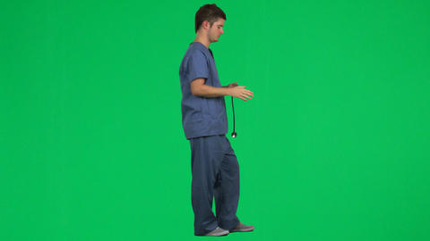 Footage Of A Male Doctor Using His Stethoscope stock footage