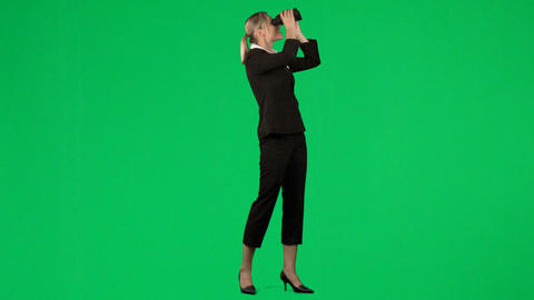 Businesswoman looking through binoculars agaisnt g Stock Video Footage