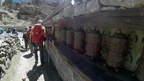 HIMALAYAS, NEPAL - MARCH, 2014: Tourists spins a g Stock Video Footage