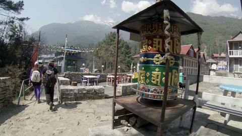 HIMALAYAS, NEPAL - MARCH, 2014: Tourists spins a g Footage