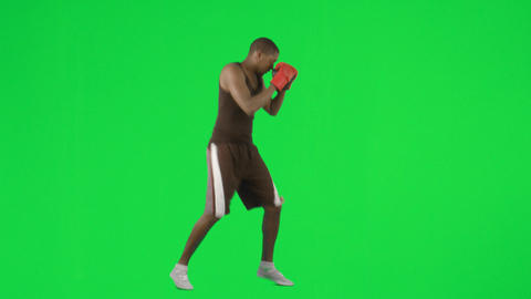Young ethnic man boxing against green screen footage Footage