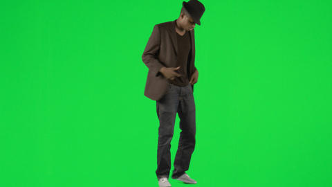 AfroAmerican young man dancing with a hat and a ja Footage