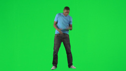 AfroAmerican man singing and dancing against green Footage