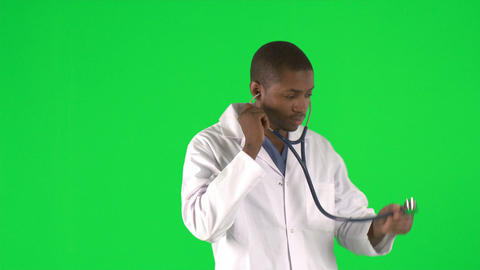 Footage of an AfroAmerican male doctor using his s Stock Video Footage