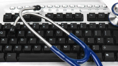 Panorama of a stethoscope on a keyboard with elect Stock Video Footage