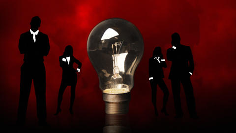 Business People Silhouettes Around A Lightbulb. Co stock footage
