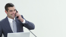 Panorama of businessman talking on phone in office Footage