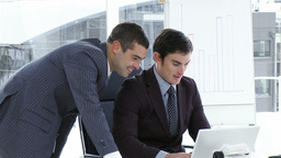 Businessmen working with a laptop in office Footage