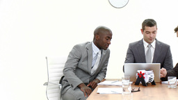 Panorama of three businessmen in a meeting Footage