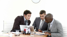 Three businessmen in a meeting talking about busin Stock Video Footage