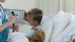 Female doctor examining a little patient Stock Video Footage