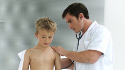 Doctor listening to a child with stethoscope Footage