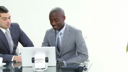 Two businessmen working in office together Stock Video Footage
