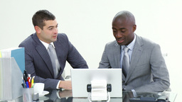 Two businessmen working in office together Footage