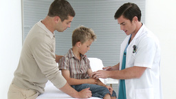 Doctor giving a little kid an injection Stock Video Footage