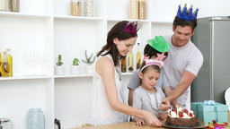 Family celebrating daughters birthday at home Stock Video Footage