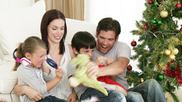Children and parents playing with Christmas presen Footage