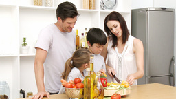 Family working in the kitchen Stock Video Footage