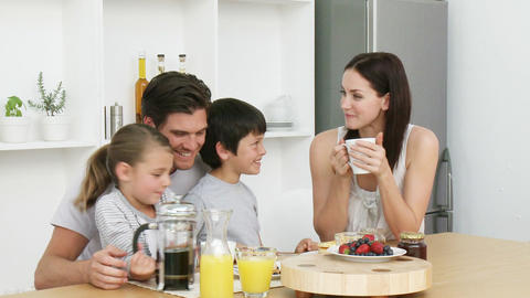 Happy family having breakfast Stock Video Footage