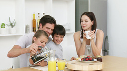 Happy family having breakfast Footage