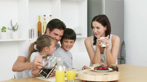Happy family having breakfast Stock Video Footage