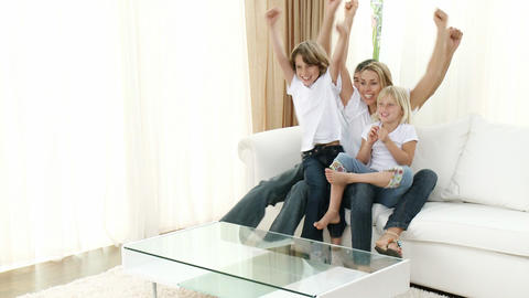 Family Celebrating A Goal At Home stock footage