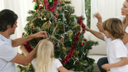 Family decorating the Christmas tree Footage