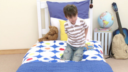 Happy boy playing with a train in his bedroom Stock Video Footage