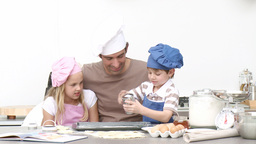Father baking cookies with his children Footage