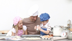 Father baking cookies with his children Stock Video Footage