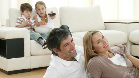 Family in livingroom watching television Footage