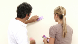 Couple with colour samples to paint new house Footage