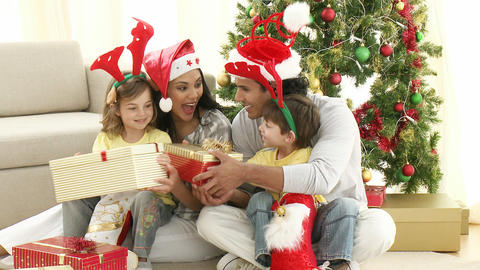 Family opening Christmas gifts at home Stock Video Footage