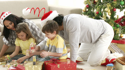 Family playing with Christmas gifts at home Footage