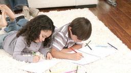 Children painting in livingroom Stock Video Footage