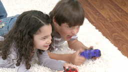 Children playing video games in the livingroom Stock Video Footage