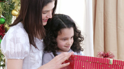 Close up of mother and daughter opening Christmas Stock Video Footage