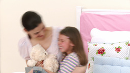 Mother and daughter playing on bed Stock Video Footage