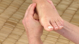 Young woman having a foot massage Stock Video Footage