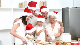 Family doing their Christmas baking in the kitchen Footage