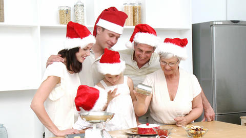 Family doing their Christmas baking in the kitchen Stock Video Footage